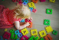 Little baby girl learning numbers and math. Education stock photos