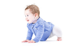 Little baby girl learning to crawl Stock Photo