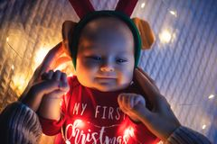 Little baby girl lie on the bed, christmas theme stock photography