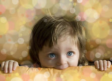 Little baby girl looking from a box - celebration Royalty Free Stock Photos