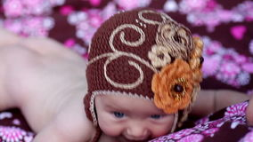 Little baby girl lying on a colorful blanket stock video footage