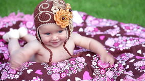 Little baby girl lying on a colorful blanket stock video