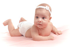 Little baby girl lying down isolated Stock Photography