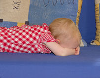 Little baby girl lying face down Stock Images