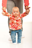 Little baby girl making first steps Royalty Free Stock Photography