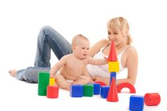 Little baby girl and mother play with toys Royalty Free Stock Images
