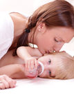 Little baby girl and mother Royalty Free Stock Images