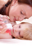 Little baby girl and mother Stock Photography