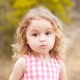 Little baby girl on nature background Stock Images