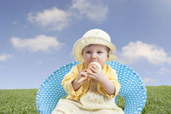 Little baby girl outdoors eating ice cream Royalty Free Stock Photo
