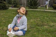Little baby girl in park Stock Photo