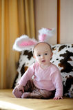 Little baby girl with pink bunny ears Stock Photography
