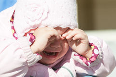 Little baby girl in pink clothes crying, closeup portrait Royalty Free Stock Photo