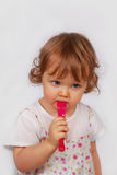 Little baby girl  with pink fork Stock Image