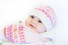 Little baby girl in a pink hat and scarf Stock Images
