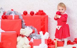 Little baby girl play near pile of gift boxes. Family holiday. Christmas activities for toddlers. Christmas gifts for. Toddler. Things to do with toddlers at stock images