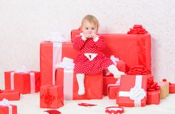 Little baby girl play near pile of gift boxes. Family holiday. Christmas gifts for toddler. Gifts for child first. Christmas. Celebrate first christmas. Baby royalty free stock photo
