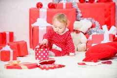Little baby girl play near pile of gift boxes. Family holiday. Gifts for child first christmas. Christmas activities for. Toddlers. Christmas miracle concept stock photography
