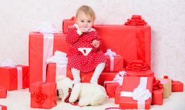 Little baby girl play near pile of gift boxes. Family holiday. Things to do with toddlers at christmas. Christmas gifts. For toddler. Celebrate first christmas stock image