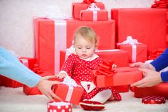 Little baby girl play near pile of gift boxes. Gifts for child first christmas. Celebrate first christmas. Sharing joy. Of baby first christmas with family royalty free stock photo
