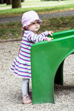 Little baby girl and playground slide Royalty Free Stock Images