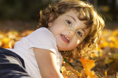 Little baby girl playing in Autumn Royalty Free Stock Photography