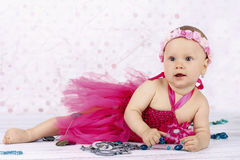 Little baby girl playing with beads Stock Photos