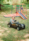 The little baby girl playing at car Royalty Free Stock Photo