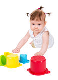 Little baby girl playing with childs toy stacking Stock Images