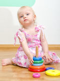Little baby girl playing Royalty Free Stock Photography
