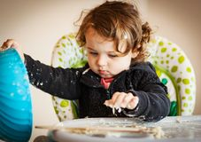 Little baby girl playing with dough Stock Photography