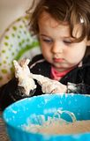 Little baby girl playing with dough Royalty Free Stock Images