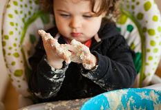 Little baby girl playing with dough Royalty Free Stock Photos