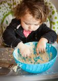 Little baby girl playing with dough Royalty Free Stock Photography
