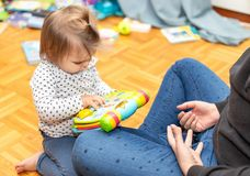 Baby. Girl. Joy. Reading. Book. Mother stock image
