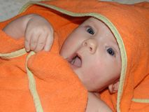 Little cheerful baby girl baby takes sun and air baths, skin dipping. stock photo