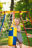The little baby girl playing at outdoor playground royalty free stock images