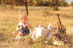 Little baby girl playing outdoors. Portrait of cute baby girl playing outdoors Stock Photo