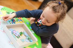 Little baby girl playing with puzzle 2 Stock Photography