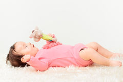 Little baby girl playing with rattle Royalty Free Stock Photo