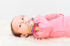 Little baby girl playing with rattle Royalty Free Stock Images