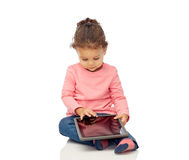 Little baby girl playing with tablet pc computer Stock Photo