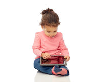 Little baby girl playing with tablet pc computer Royalty Free Stock Images