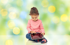 Little baby girl playing with tablet pc computer Stock Photos
