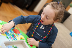 Little Baby Girl Playing With Puzzle Royalty Free Stock Photography