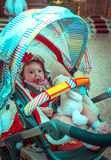 Little Baby Girl in the Pram Stock Photo