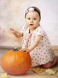 Little baby girl with pumpkin Royalty Free Stock Image
