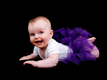 Little baby girl in purple tutu stock photography