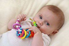 Little baby girl with rattle stock images