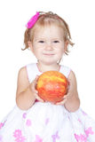 Little baby girl with red apple Royalty Free Stock Image
